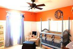 This orange and blue nursery is so preppy!