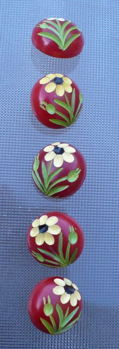Five Red Bakeite Flower Buttons