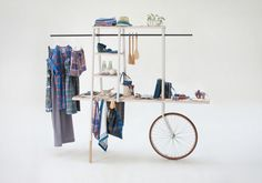 bicycle + ironing board + ladder + clothes pole + shelf extravaganza.