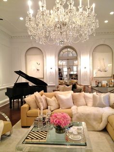 Piano in the back makes this room 10x grander, though the chandelier just is so elegant this room couldn't be any more elegant