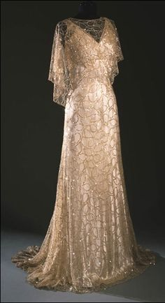 Woman's evening ensemble with dress, caplet and belt in silk satin with ivory lace tulle and sequin embroidery. France ca. 1933