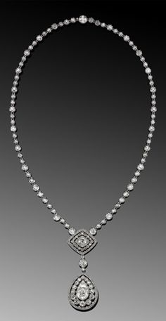 Edwardian Diamond Filigree Pendant Necklace, circa 1905. A double pendant of old European cut diamonds is suspended from a riviere with a total of approximately 22 carats mounted in platinum.