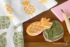 Make DIY rubber stamps to add fun patterns to plain dishtowels! Our pineapple and artichoke printables are super fun for the kitchen.