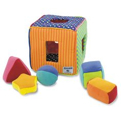 Soft Shape Sorter - The five soft shapes are matched to the corresponding posting hole by their shape and each has a rattle inside. Babies will love putting the shapes in and taking them out again.