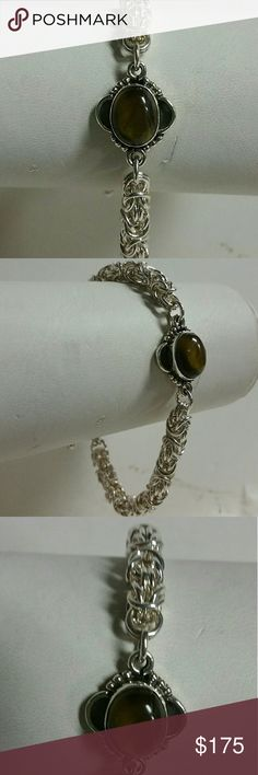 """♨️ .999 FINE SILVER ♨️ Bracelet This is an exceptional, handmade bracelet! Made of a fine silver (. 999) Byzantine Weave, with a gorgeous tiger eye sterling silver focal point bead. Toggle clasp. Bracelet measures 7 1/2""""  * All of my handmade jewelry is made from glass beads and real gemstones.  Please comment with any questions, I'm always happy to answer them! Jewelry Bracelets"""