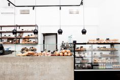Kanniston Leipomo in Helsinki Helsinki, Barcelona, Kitchen Workshop, Bakery Interior, Kitchen Design, Photo Wall, Shelves, Ceiling Lights, Bakery Shops