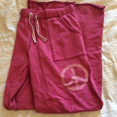 Red Boyfriend Sweatpants VS Pink light red boyfriend sweats. They run big and are on the thinner side, not fleece lined. These are great for someone who is looking for a comfy pair of lounge pants to wear around the house. These have been well loved! Willing to negotiate price, just make an offer using the feature 💕 no trades, posh only PINK Victoria's Secret Pants