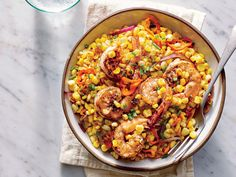 Brined Shrimp with Charred Corn Salad | Seared shrimp with a quick spice rub pairs with pan-charred summer vegetables in this simple dish that pops with fresh flavor. A little vinegar balances the sweetness of the caramelized veggies and also complements the shrimp. Fresh basil, parsley, and thyme would also work in this dish if you have them on hand.