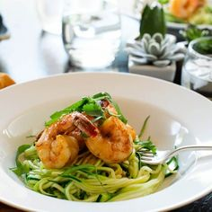 Spicy Shrimp with Zucchini Noodles Recipe - If I were to diet, this is just the type of food I would eat. Spicy and satisfying, the Asian-style shrimp spiked with sriracha pairs great with healthy ribbons of zucchini noodles.