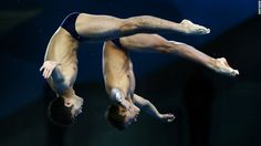 German Sanchez Sanchez and Ivan Garcia Navarro of Mexico compete in the men's synchronized 10-meter platform diving event Monday.