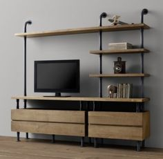 RH baby&child's Industrial Pipe Media Shelving:Sturdy steel pipes and matching cast fittings serve as the structure for our hardworking pieces, while warm wood planks provide support for books and a workspace for the industrious.