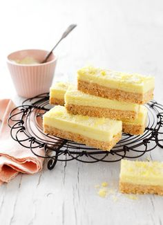 This delectable lemon coconut slice is the perfect blend of zesty and sweet. This no-bake slice makes for a delicious afternoon or morning tea and can be even given as a edible gift. No Bake Lemon Slice, Lemon Coconut Slice, No Bake Slices, Cake Slices, Lemon Recipes, Raw Food Recipes, Baking Recipes, Sweet Recipes, Cake Recipes