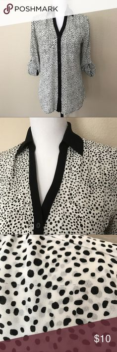 Express Portofino Shirt black and white dot Original fit Portofino. A few hairline snags but not very noticeable on. Convertible sleeves. Express Tops Blouses