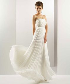 This is a strapless wedding dress with soft pleated skirt