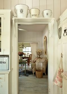 Shabby Chic - love the shelf above the door. Maybe for least used items?