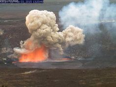 In this May 3, 2015 photo provided by U.S. Geological Survey Hawaiian Volcano Observatory, smoke and lava explode from Kilauea volcano on Hawaii's Big Island. Molten lava and rocks went flying through the air after part of the crater wall collapsed and caused the explosion. (USGS Hawaiian Volcano Observatory via AP)