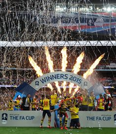 The Arsenal team celebrate winning the FA Cup Final between Aston Villa and Arsenal at Wembley Stadium on May 30, 2015.