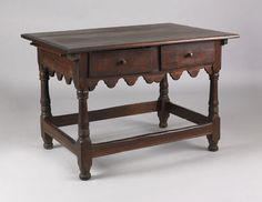 """Pook & Pook.  April 20th & 21st 2007. Lot 434.  Estimated: $8K - $12K. Realized Price: $22,230. Pennsylvania walnut tavern table, the molded edge battened lift top overhanging a base with 2 drawers, the left inlaid """"1770"""", an elaborate scalloped skirt supported by baluster turned legs joined by square stretchers, 29 1/2"""" h., 43 3/4"""" w. Provenance: Jess Pavey."""