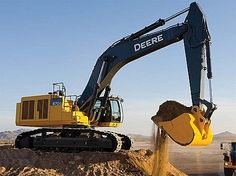 John Deere Excavator 870G This image can be good to read an information book about construction vehicles.