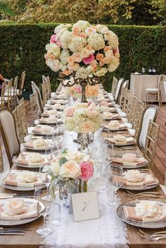 A huge mixed bouquet of romantic pastel an ivory flowers decorates the center of this table.