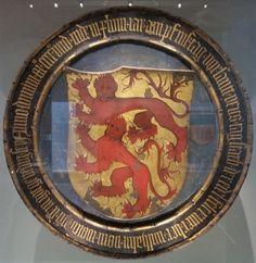 Totenschild des Wilhelm I. von Wolffstein (gest. 1448) (Totenschild) Datierung: Mitte 15. Jahrhundert Ort: Regensburg Material/Technik: Fichtenholz, bemalt und vergoldet, Eisen, Strickband, Leinwand, Kreidegrund, Tempera Maße: Dm. 108,5 cm Marke/Inschrift: Anno . dmimi . M° . CCCC° . vnd . in . dem . XIVIII . Iar . am . pfinstag . vor . santt . veits . tag . starb . der . edle . fest . ritter . her . wilhalm . vom . wolfstein . dem . gott . genedig . sey