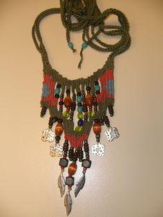 Anastasia Iordanaki- necklace:,cotton, glass and wood beads,metal parts