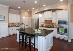 This curved island provides bar seating. The Bluestone #1302. http://www.dongardner.com/house-plan/1302/the-bluestone. #Kitchen #IslandKitchen #DreamHome