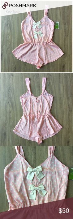 """NWT Kate Spade polka dot luxe printed romper M Wake up ready for some morning fun in this flirty pink polka dot romper.  * NWT * V-neck with bow detail * Elastic cinch waist * Pull-on styling; keyhole openings at front and back * Wide straps taper at bodice * Loose lettuce edge hemline hits at upper thigh * Baby pink with white polka dots and bows * Bust: 16"""" approx. laying flat * Length: 19 1/2"""" approx. laying flat from underarm to hem * 100% polyester * Machine wash, tumble dry  * Bundle…"""