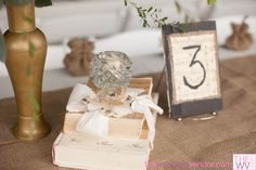 Vintage table decor ideas from www.TheWV.com. DIY table numbers. Vintage wedding ideas. Photo courtesy of Daniel James Photography