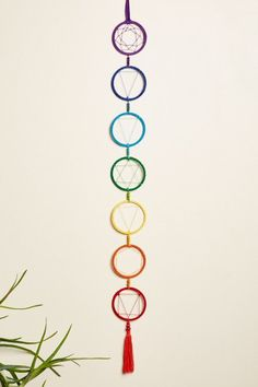 Display the seven energy points, or chakras, with this colorful wall hanging featuring the chakra symbols. Each color and symbol represents a different chakra within your body. This wall hanging includes brightly colored beads and a long tassel. Chakra Symbols, Chakra Art, Meditation Corner, Chakra Meditation, Fun Crafts, Diy And Crafts, Arts And Crafts, Simple Crafts, Summer Crafts