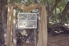 Burlap and Vintage Window Make a Perfect Backdrop for this Outdoor Wedding Ceremony