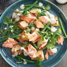 SEARED TROUT, CRISPY POTATOES AND BEANS WITH HORSERADISH DRESSING, a delicious recipe from the new Cook with M&S app. Horseradish Recipes, Greek Style Yogurt, Roasting Tins, Crispy Potatoes, Tasty, Yummy Food, Spinach Leaves, Serving Plates, Trout