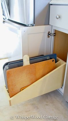 Turn your kitchen drawer into filing style cabinets to easily store baking sheets and cutting boards. Repurpose a wire filing rack or purchase custom cabinet inserts/