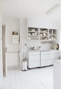 Great mixture of old house with nooks and crannies and new but modest kitchen furniture. The small details around the ceiling stucco list, the medicine cabinet over the radiator and subtle the white  fluorescent tubing.