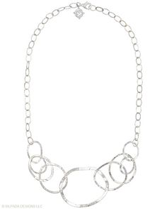 Toast to great style with this playful and powerful bib Necklace. Sterling Silver.