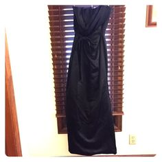 Party gown for Black Tie Affair Gorgeous black strapless gown by Vera Wang White Collection. Gown is in great condition. Worn once and now I don't fit into it. Has a zipper in the back and a ribbon belt. It is absolutely beautiful on. Vera Wang Dresses