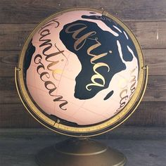 Love this hand-painted globe by 1Canoe2 Letterpress...I can't wait until they begin production on them again