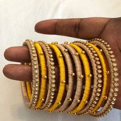 Source by qshama. Silk Thread Bangles Design, Silk Bangles, Silk Thread Earrings, Bridal Bangles, Thread Bracelets, Thread Jewellery, Fabric Jewelry, Cuff Bracelets, Handmade Beaded Jewelry