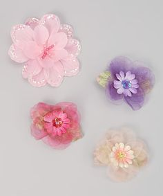 Delicate with a touch of girlish whimsy, these clips are perfect for a fairy-filled day. Flowers in vibrant hues add a dash of magic to a day filled with garden adventures.