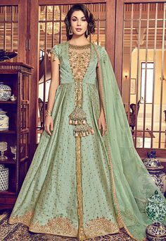 Green And Peach Jacquard Silk Heavy Jacket Style Floor Length Anarkali Suit Product Details : Beauty and royalties comes together in this beautiful drape. Be the center of attraction with this green and peach color wedding wear jacket style salwar k Salwar Kameez, Kurti, Abaya Style, Designer Anarkali, Saris, Abaya Fashion, Fashion Dresses, Icon Fashion, Eid Dresses