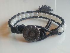 Boho Chic style leather wrap bracelet sunflower button with white beads -  tassel and flower charm attached with lobster clasp by Lauralynnmichelle on Etsy