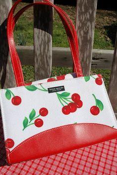 Counterfeit cherry handbag.