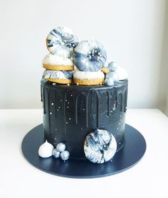 Moonbean Drip Cake with grey,  black, and white Donuts and sparkles. For Star Wars, perhaps?