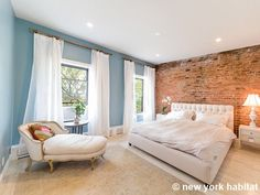 This bedroom features a stylish brick wall, queen bed, chaise longue, two large windows, and hardwood floors http://www.nyhabitat.com/new-york-apartment/furnished/15801