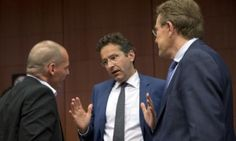 Greek Finance Minister Yanis Varoufakis, left, speaks with Dutch Finance Minister Jeroen Dijsselbloem, centre.