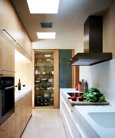 Open pantry at the end of a galley kitchen.