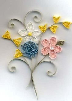 What is quilling?  Quilling is the art of taking long thin strips of paper and coiling, looping and shaping them into various designs. These are quilled flowers and other quilling tutorials