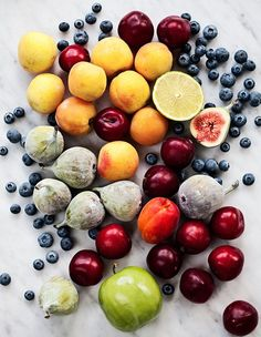 Fruitspiration or  collage of fruits: different assortments - fig, orange, apple, cherries, apricots