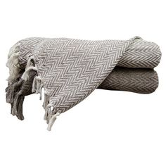 Curl up beneath this cozy chevron-print cotton throw and enjoy a mug of tea and your favorite mystery novel, or toss it over the arm of your sofa for a pop o...