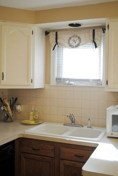 Easy Kitchen curtain. Nice. Nix the monogram